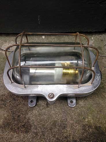 vintage maritime light oval caged bulkhead side