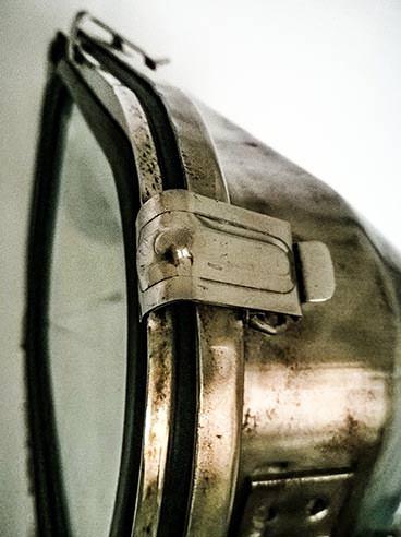 Vintage rectangular ship's cargo light on steel tripod - detail
